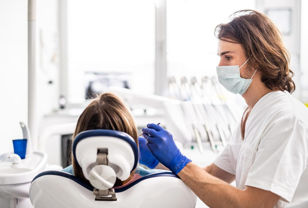 a-dental-check-up-of-patient-in-dentist-surgery-74RDR5Y